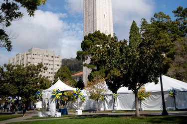 Homecoming Headquarters tents by the Campanile clock tower