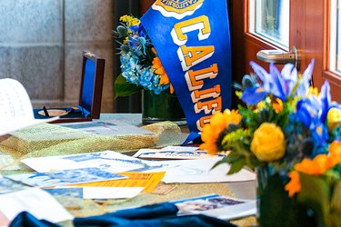 California pennant with blue and gold flowers on a table of pamphlets