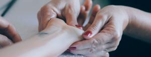 Hand being moisturised to improve nail health