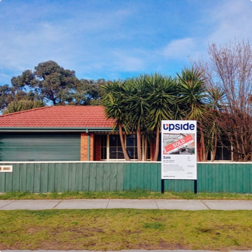 Sold property with an Upside signboard
