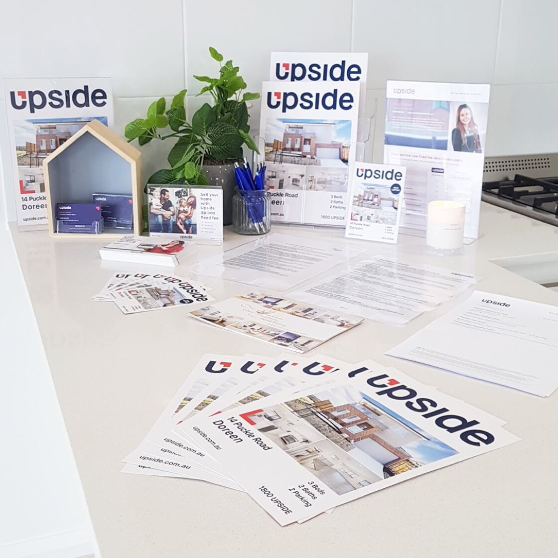Signboard, brochures and advertising from Upside