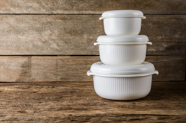 C1035fc3 empty containers for food on wooden background 35380 79