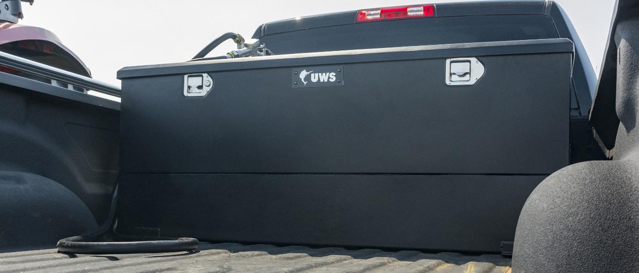 UWS black steel-aluminum combo transfer tank in truck bed