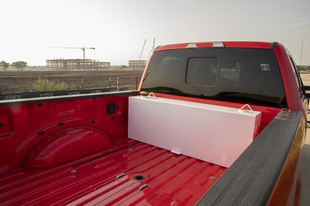 UWS white rectrangular steel transfer tank in a red truck