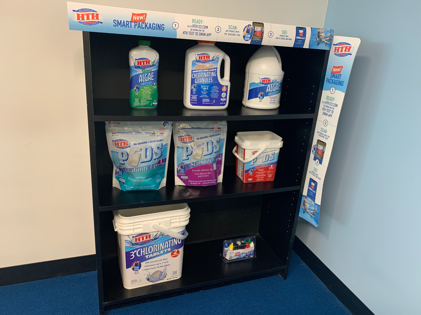 Display shelf with products and shelf talkers