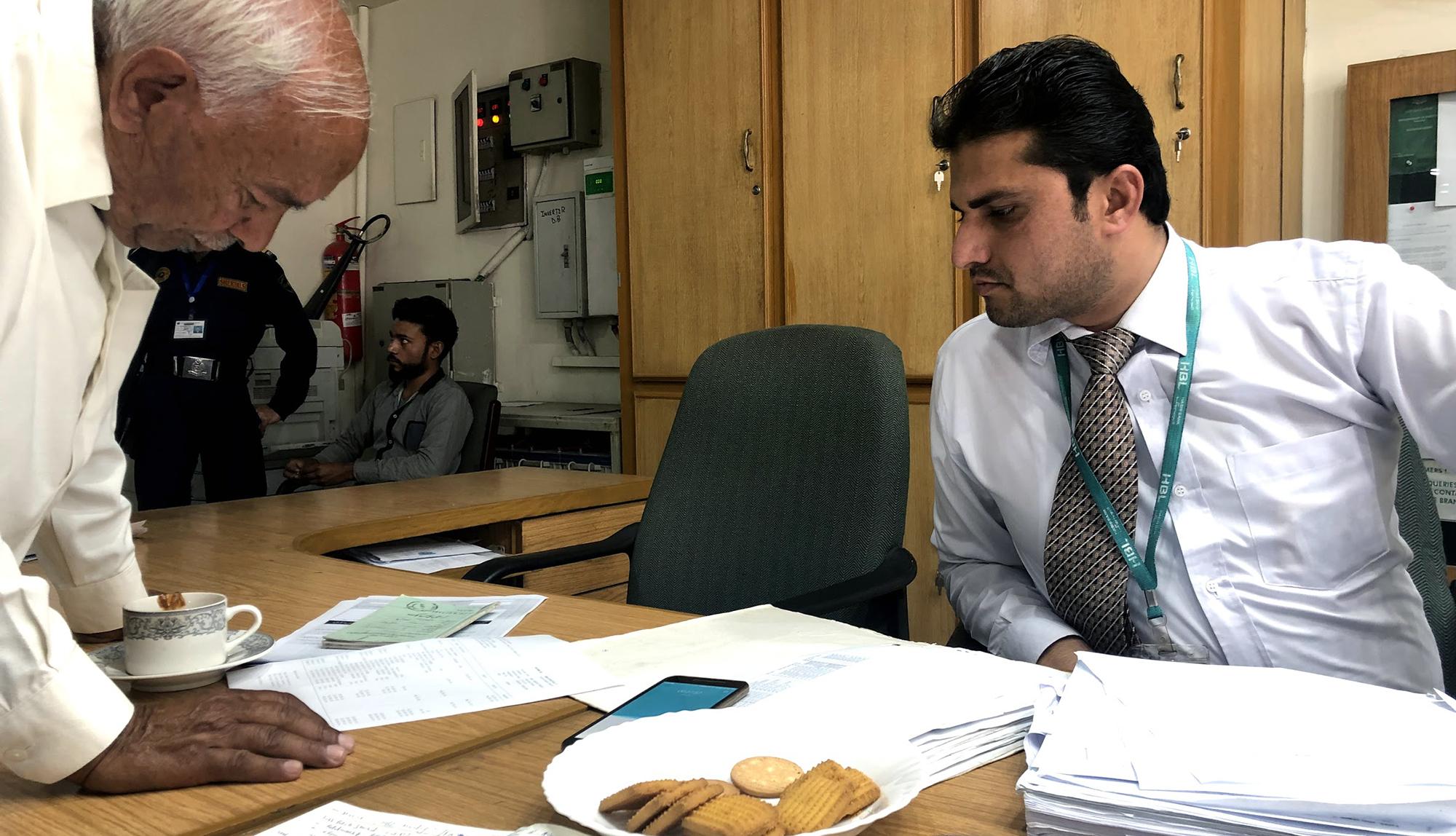 A smallholder farmer inquiring about loan applications at a bank near Kasur (Pakistan)