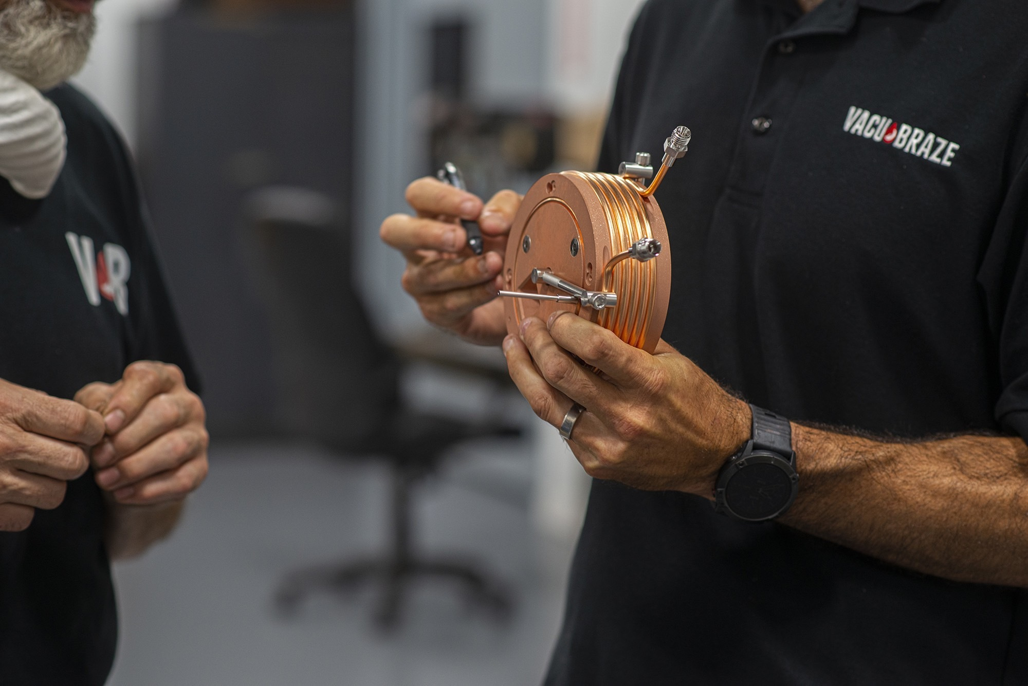 Close up of Vacu Braze team member reviewing parts