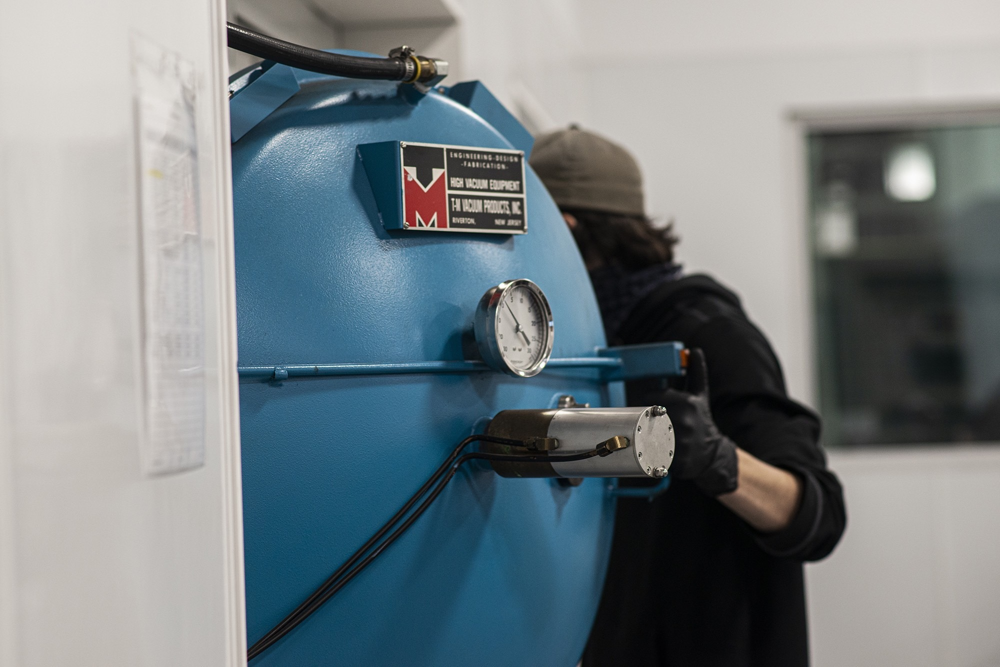 Close up of Vacu Braze employee closing door