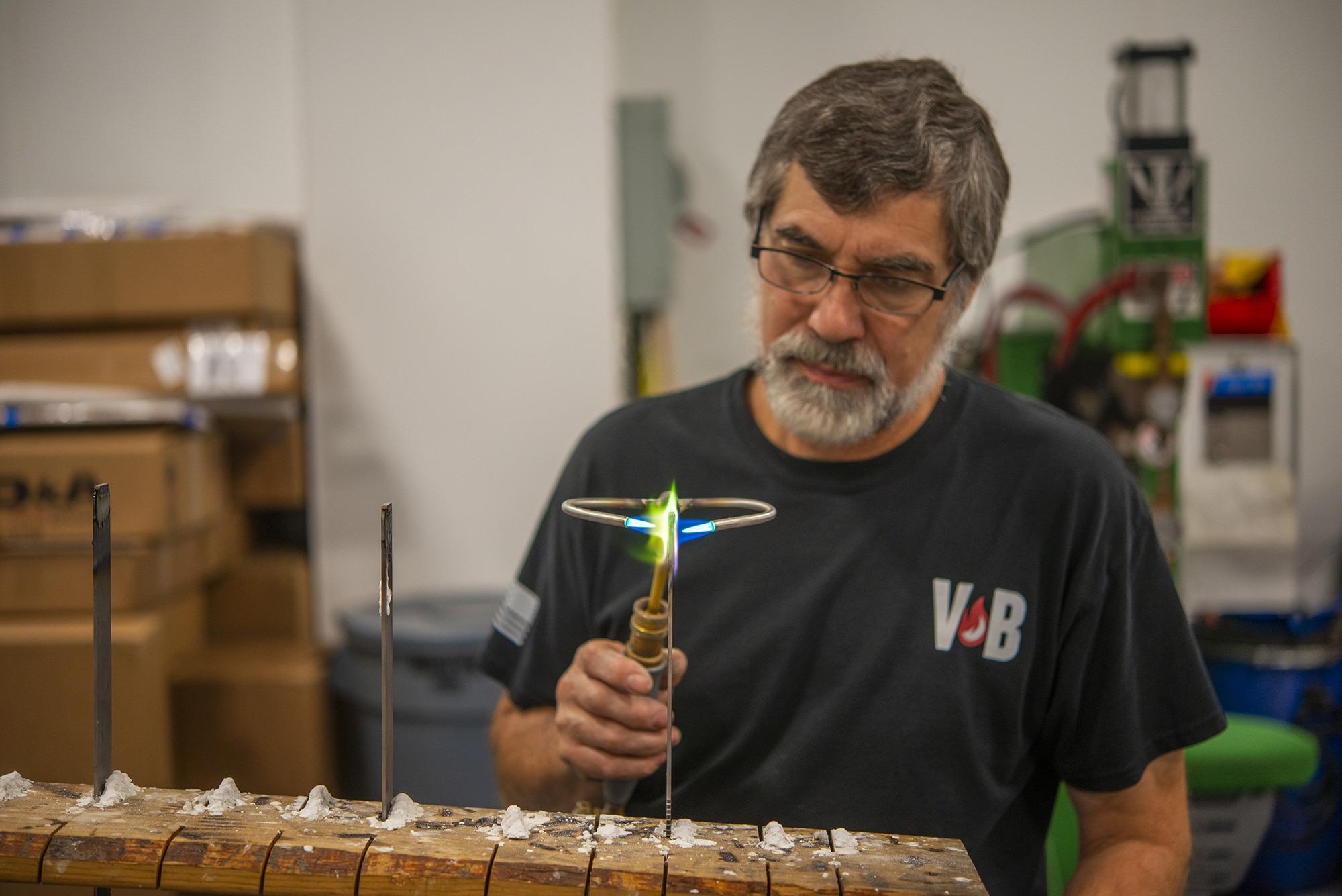 Vacu Braze team member uses torch brazing