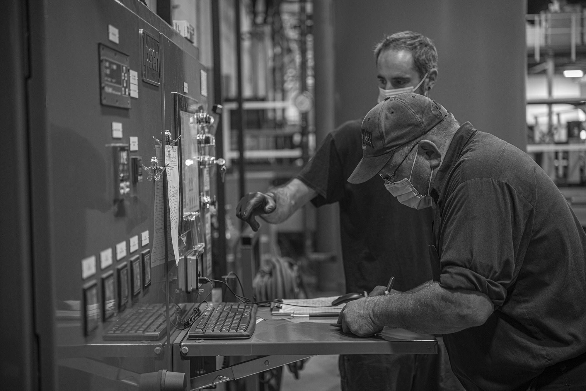 Vacu Braze team works with heat treatment machinery