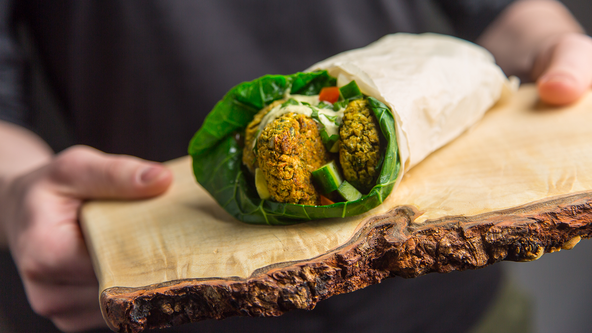 crispy chickpea falafel wrap on a cutting board