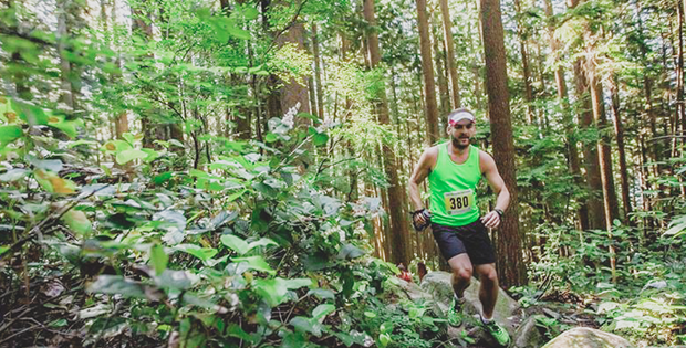man trail running through the forest