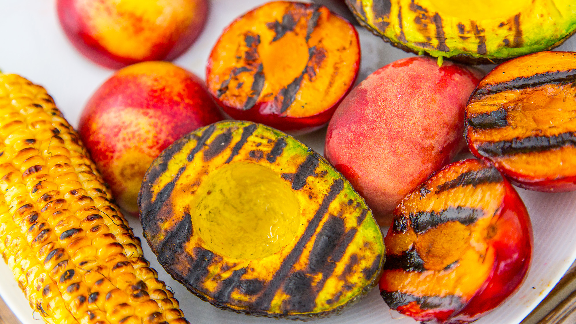 grilled avocados, peaches, and corn