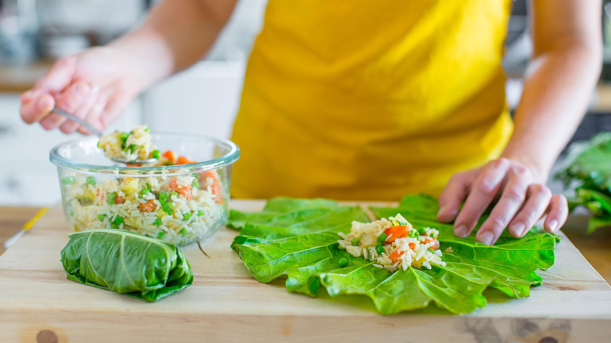 putting fried rice in collard green leaf