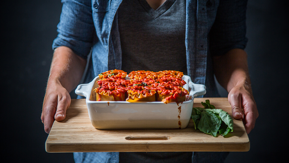 vegan lasagna rolls in a casserole dish