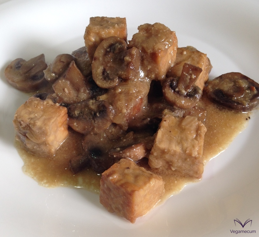 Tempeh with mushrooms and almond sauce