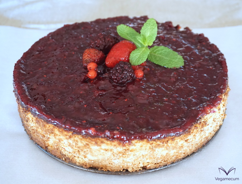 Vegan cheesecake with finished berry topping