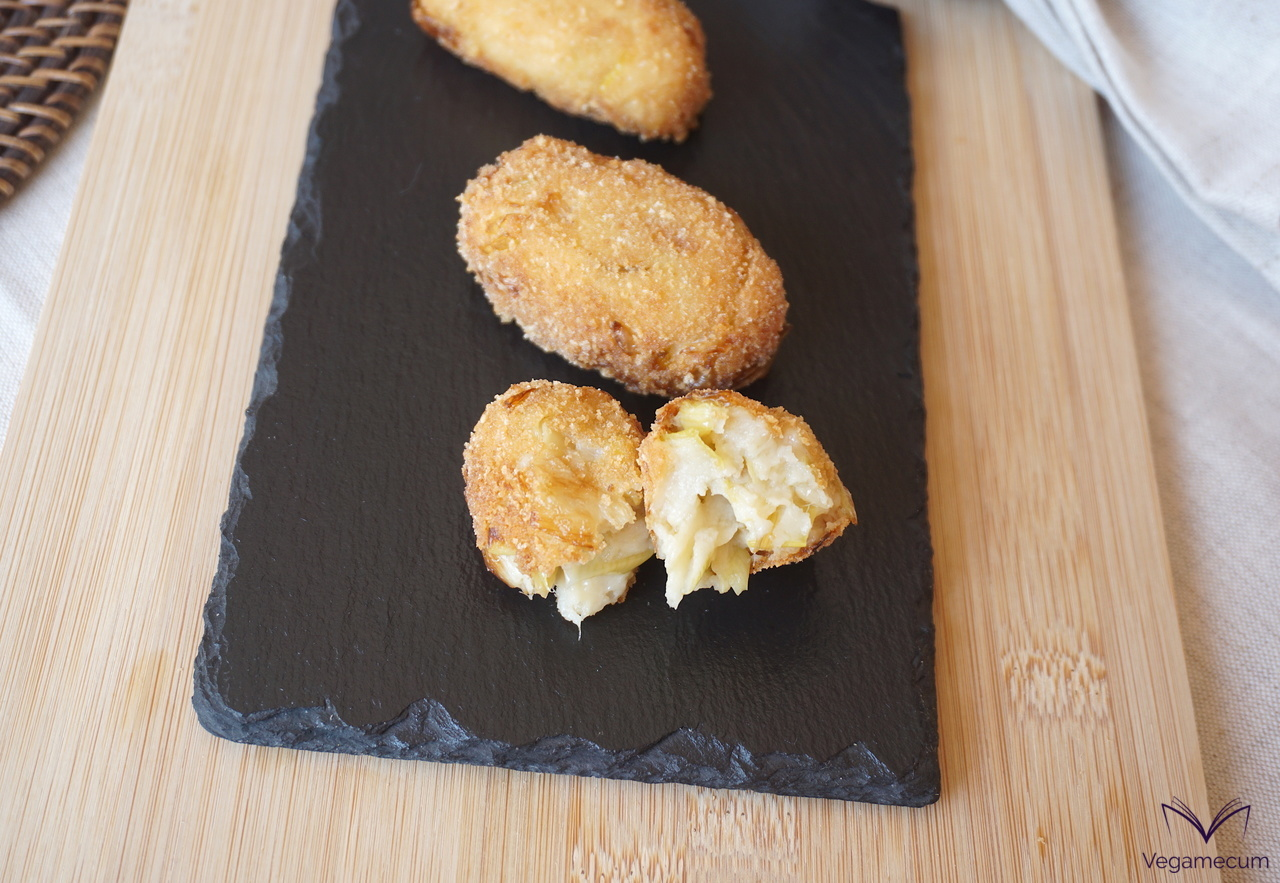 Detail of vegan cheese croquettes and caramelized leek
