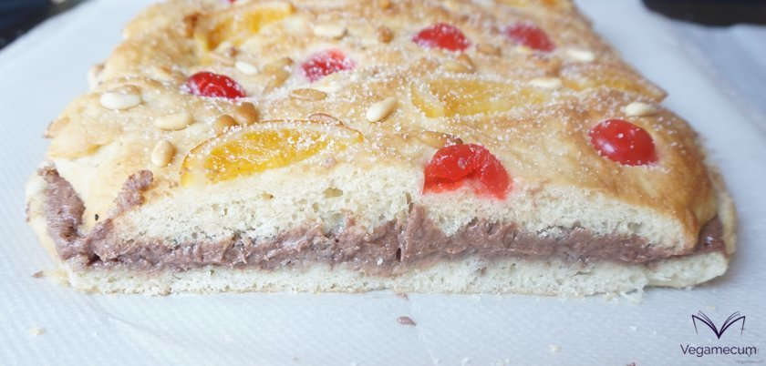 Detail of the cut of the coca of Sant Joan of fruit and vegan truffle