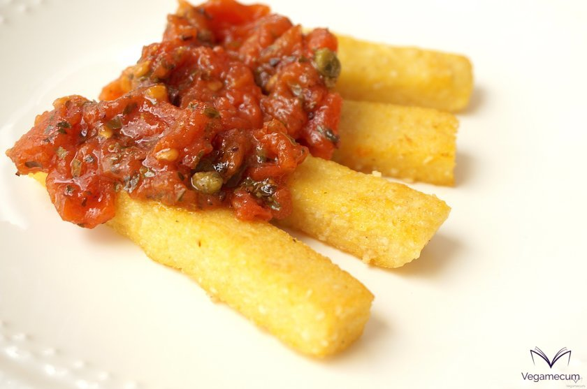 Parmesan flavor polenta sticks served with puttanesca sauce
