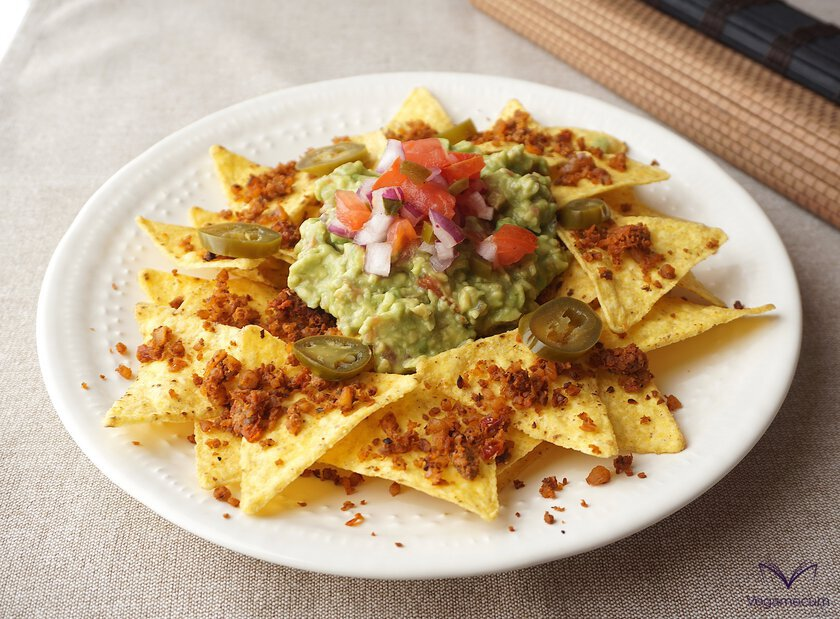 Walnut meat chorizo flavor on nachos with guacamole and pico de gallo