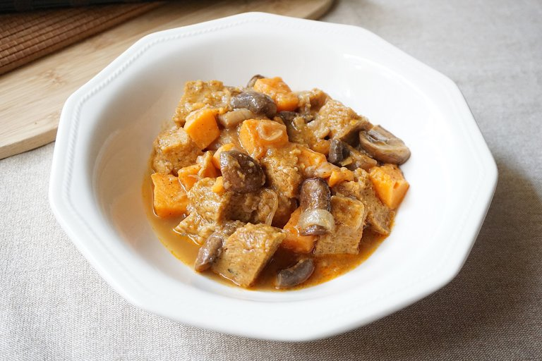 Cinnamon seitan stew with sweet potato and portobello
