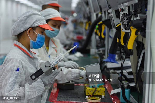 Anh-san-xuat-moy-tho-Made-in-Vietnam-tràn-ngap-AFP,-Bloomberg,-Reuters-hinh-anh-2