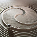 New Kinetic Art Tables Draw Hypnotic Designs in Sand