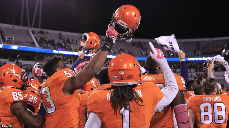 The Virginia Cavaliers players celebrate after their game against the Syracuse Orange.