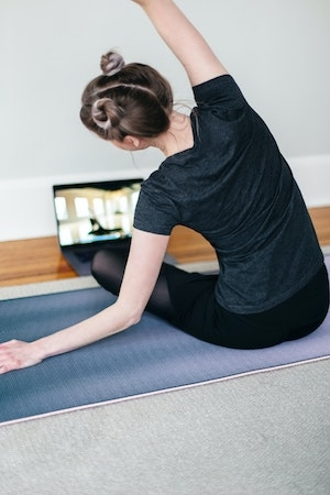 Woman exercising online session