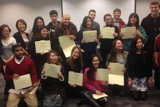 International students from English language program of NYU holding their diploma