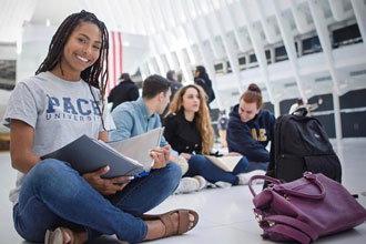 Student from English Language Program PACE University studying on campus