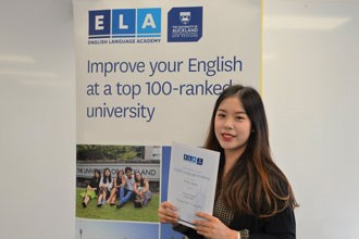 Students of the English Language Academy of the University of Auckland showing a diploma