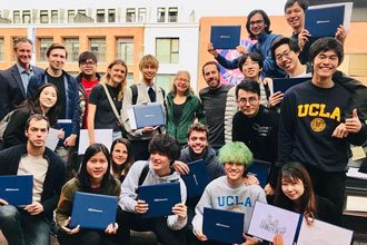 Students from the English course at UCLA Extension showing their diploma