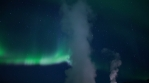 Geothermal steam rising bright Aurora borealis deep starry sky Iceland 4k.