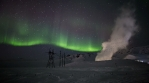 Green electricity bright aurora borealis geothermal generator power lines Iceland 4k.