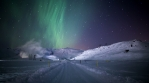 Snow covered road geothermal electricity plant aurora borealis Iceland 4k