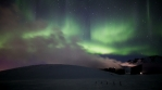 Steam from geothermal power generators strong realistic aurora borealis Reykjavik Iceland 4k