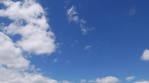 Moving clouds in blue sky