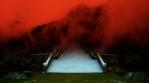 Zen bridge, stairway crossing mountain valley fog, dark red sky abstract