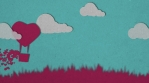 Love and valentine day. Pink hot air balloon and white clouds flying over grass with heart float on blue sky. Hearts emission from the basket. Carton animation style. Seamless loop.