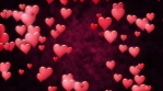 Red hearts fly annd glow at dark red abstract background. Seamless loop.