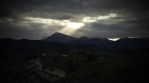 Light beams piercing through cloud cover over southern Spain countryside