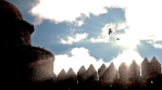 Ravens silhouetted by sun beams soaring over castle walls in slow motion, Calahorra Spain