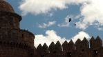 Ravens soaring over castle walls in slow motion, Calahorra Spain