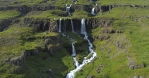 Beautiful remote twin waterfalls, Mjoifjordur Iceland drone aerial summer sunny day