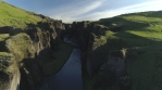 Flying over Fjadragljufur glacial river canyon Iceland, morning light drone aeria