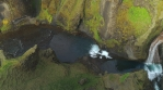 Flying over colorful volcanic river canyon waterfalls, Fjadragljufur Iceland aerial panning shot