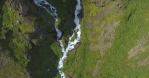 lying over waterfalls in colorful icelandic countryside, aerial looking down, Iceland