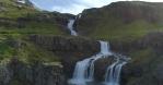 Scenic multistage Klifbrekkufossar waterfall flyover, Aerial drone shot MjofjoIrdur Iceland